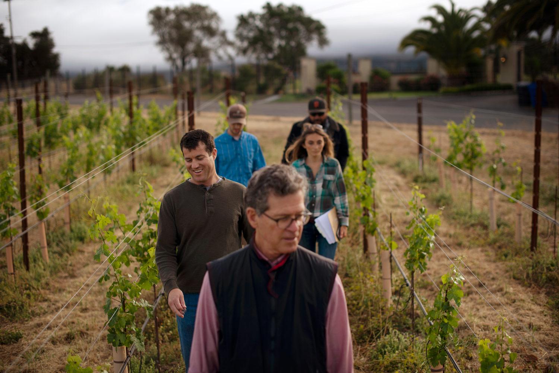 Paul Hobbs with winemaking team in vineyard